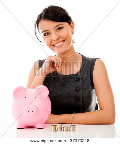 Business woman saving money in a piggybank - isolated over a white background