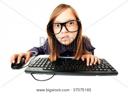 Young girl working or playing with computer, isolated on white