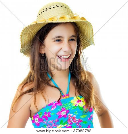 Beautiful hispanic girl wearing a colorful swimsuit and a straw hat laughing isolated on white