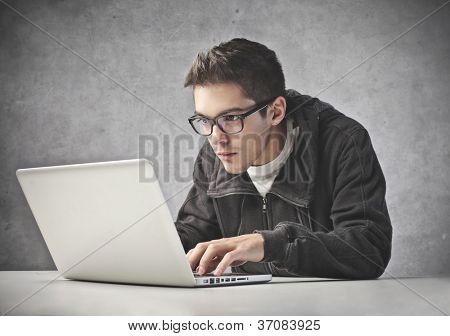 Boy using his laptop computer