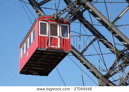 Ferris wheel with red cabine, Prater park in Vienna, Austria, closeup