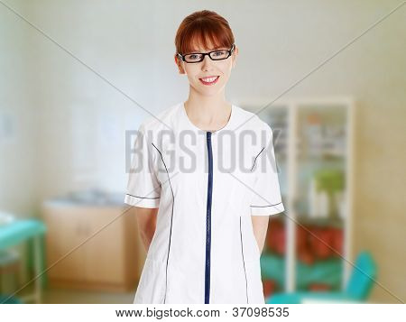 Young woman in healthcare worker uniform (doctor, beautician). Beauty spa massage therapist woman portrait.