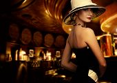 picture of fascinator  - Woman in luxury club interior - JPG