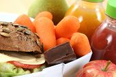 picture of school lunch  - box with sandwich fruits and chocolate and bottle of juice - JPG