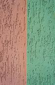 red and green striated stucco wall texture