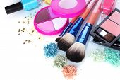 eye shadow, nail polish and make-up brushes isolated on white