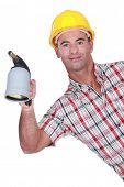 Workman with a blowtorch poster