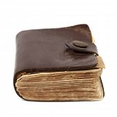 picture of leather-bound  - Old leather bound book on a wooden bookshelf - JPG