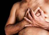 pic of breast-stroke  - Shirtless man suffering a heart attack and grabbing his chest - JPG