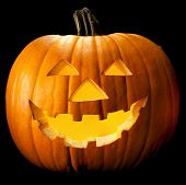 stock photo of jacking  - Halloween pumpkin head scary face with evil eye jack spooky and creepy horror lantern - JPG