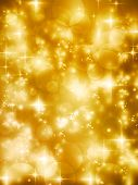 Abstract soft blurry background with bokeh lights, hightlights and stars in soft golden shades. The