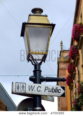 Street Lamp With A Sign For Public Toilets In France