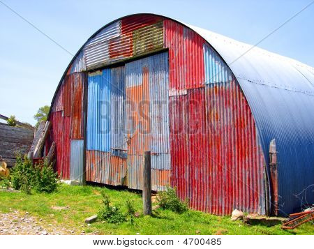 Round Metal Shed With Mismatched Paint