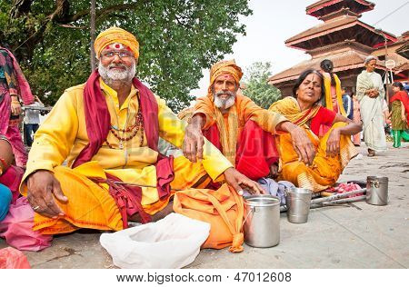 KATHMANDU, NEPAL - MAY 19: Holy Sadhues  with traditional blessing in Durbar Square on May 19, 2013 in Kathmandu, Nepal.