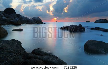 Dramatic sunset in rocky beach, Belitung, Indonesia. Long exposure shot