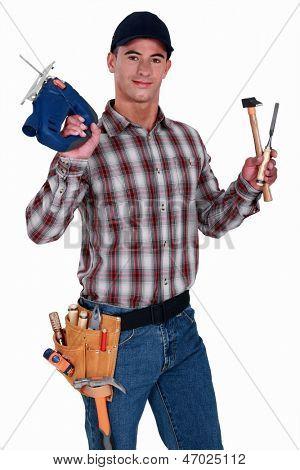 Carpenter holding drill