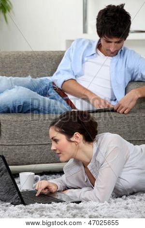 Couple slobbing around at home