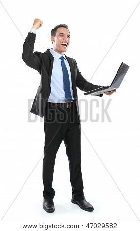 Very Happy Successful Businessman With Laptop