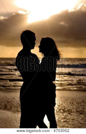 Silhouette Couple On Beach