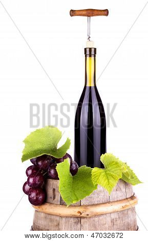 Grapes On A Barrel With Corkscrew And Wine Bottle