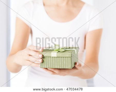 close up of woman hands holding gift box