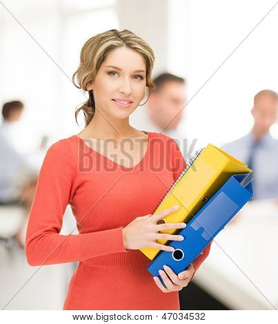 bright picture of beautiful woman with folders in office