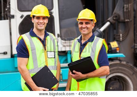 harbor warehouse worker standing in front of container forklift