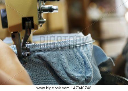 Image of machine knitting blue children's cap