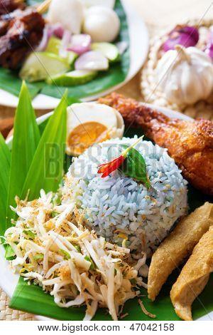 Nasi kerabu or nasi ulam, popular Malaysian Malay rice dish. Traditional east coast blue rice. Famous in states such as Terengganu or Kelantan . Malaysia food, Asian cuisine.