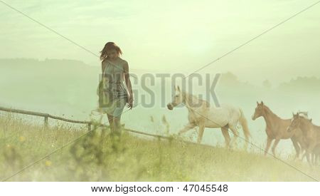 Beautiful woman and horses