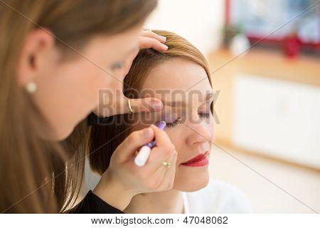 Cosmetician Applying Eye Makeup