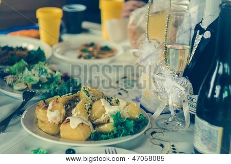 Wedding table with the decorated glasses