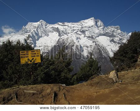 Signpost in Namche Bazar, snow capped mountain