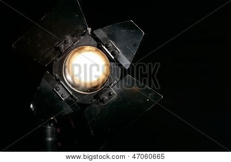 Studio floodlight on black background