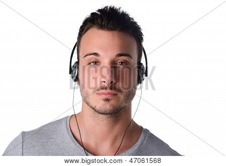 Good Looking Young Man Listening To Music With Headphones