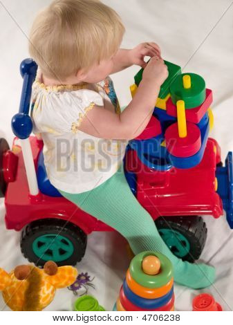 Child Sits On Toy