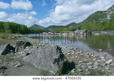 mountain river under blue sky with clouds