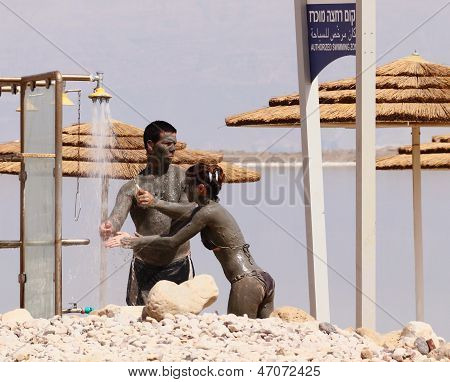 Neve Zoar, Israel - May 24: Young Caucasian  Couple Taking Mud Treatment Outdoor On Summer Day On Ma