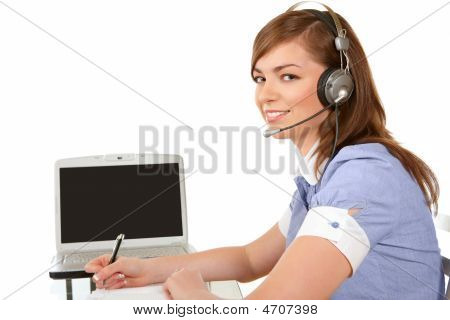 Woman With A Laptop And Headset
