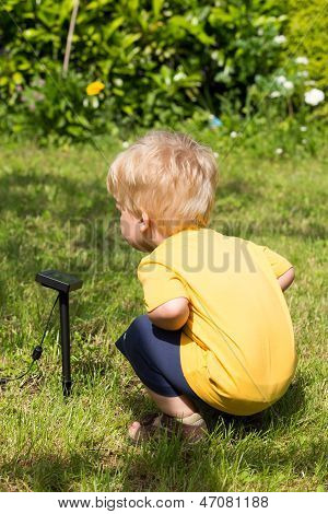 Kid Interested By Solar Battery