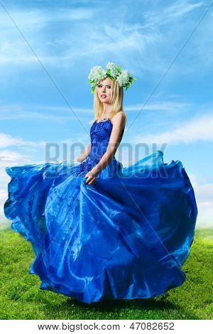Young Woman In Luxurious Blue Dress