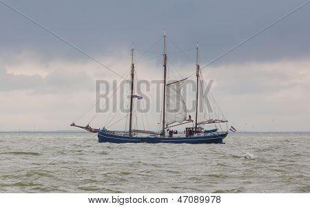 Large Sailboat In The Waters Of The Dutch Ijsselmeer