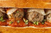 stock photo of meatballs  - Homemade Spicy Meatball Sub Sandwich with Marinara Sauce and Cheese - JPG