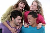 foto of foursome  - elated young foursome of students - JPG