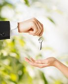 stock photo of possession  - picture of man hand passing house keys to woman - JPG