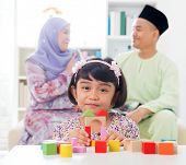 picture of malay  - Malay girl building a wooden toy house - JPG