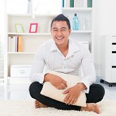 stock photo of southeast asian  - Young Asian man smiling happy - JPG