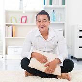 foto of southeast asian  - Young Asian man smiling happy - JPG
