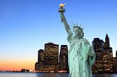stock photo of empire state building  - Manhattan Skyline and The Statue of Liberty at Night - JPG