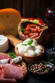 stock photo of cheese platter  - Antipasto and catering platter with different meat and cheese products - JPG